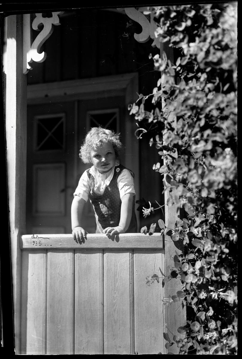 Barn på veranda