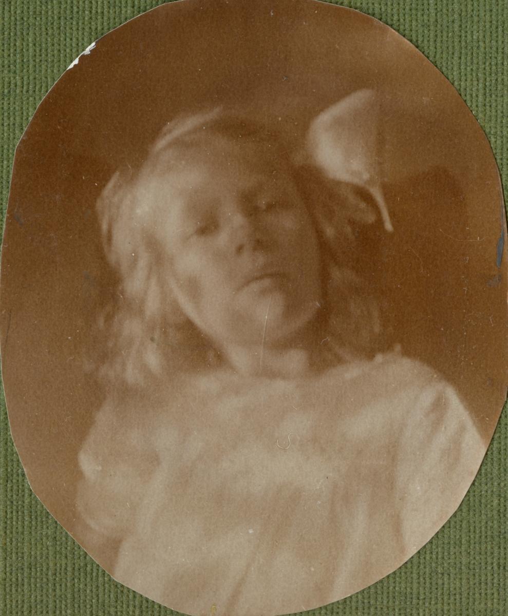 Porträtt av en flicka.