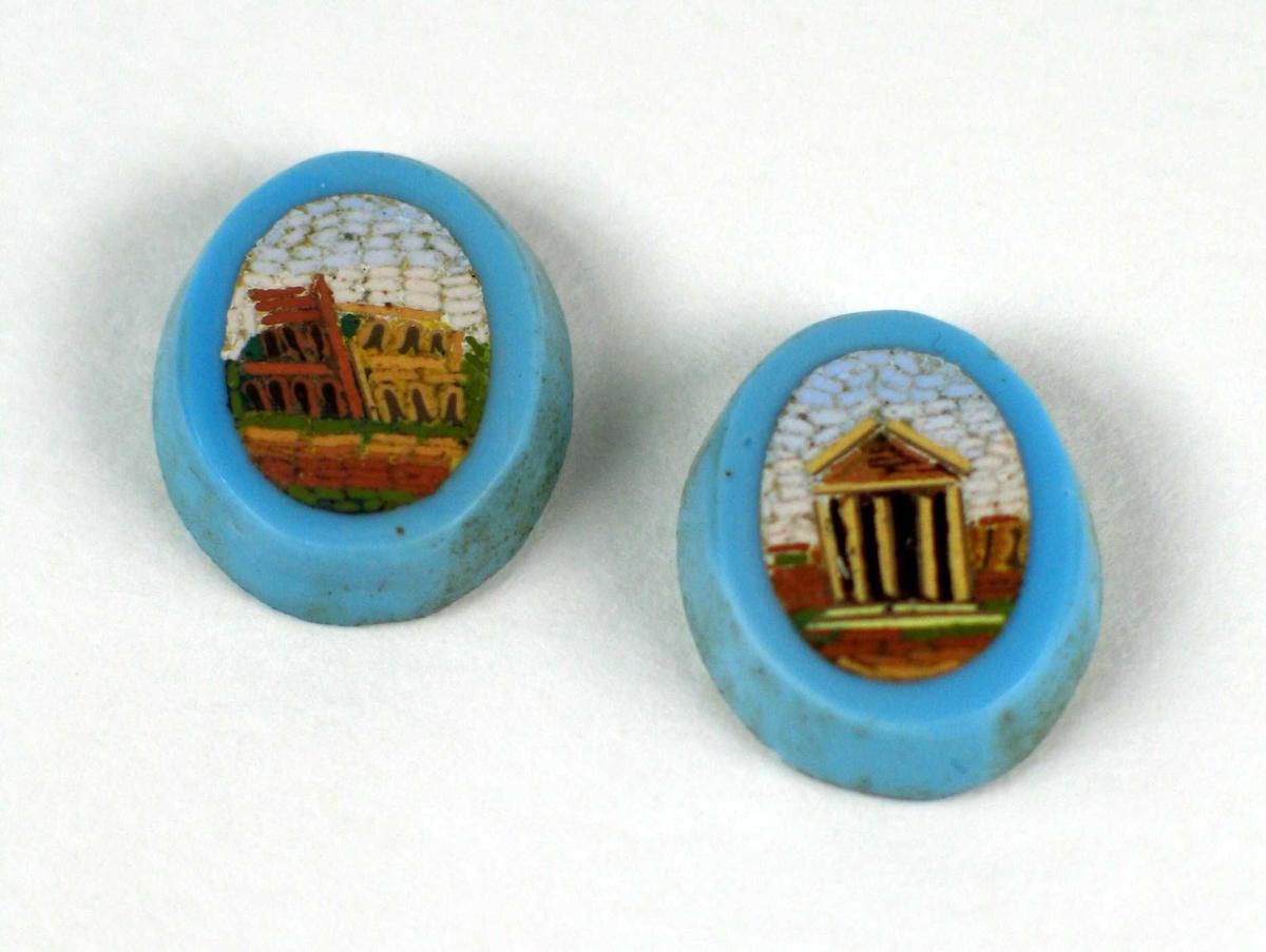 To turkise ovale knapper med mosaikkdekor. Motivet er byggverk fra antikken.