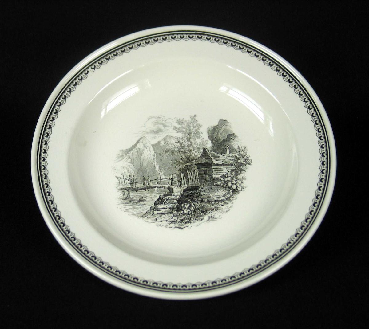 Suppetallerken i benhvit keramikk med sort dekor.